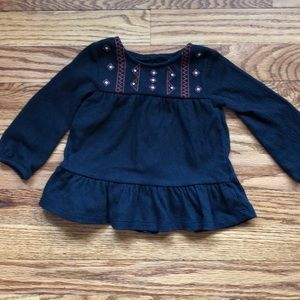 Baby girl black knit top with embroidery.